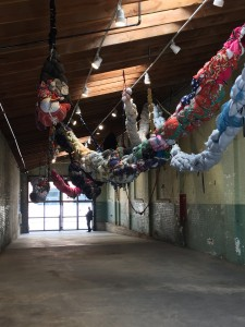 Shinique Smith, Forgiving Strands, 2015-16.  Clothing, fabric, ribbon, rope, found objects.  In breezeway.